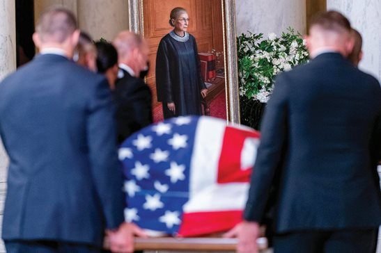 The flag-draped casket of Justice Ruth Bader Ginsburg is carried by Supreme Court police officers Wednesday into the Great Hall at the Supreme Court in Washington. Ginsburg, 87, died of cancer on Friday Sept. 18.
