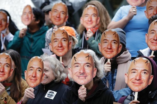 "Demonstrators hold images of Amazon CEO Jeff Bezos near their faces during an October protest at Amazon headquarters over the company's facial recognition system, ""Rekognition,"" in Seattle. San Francisco is on track to become the first U.S. city to ban the use of facial recognition by police and other city agencies as the technology creeps increasingly into daily life. Studies have shown error rates in facial-analysis systems built by Amazon, IBM and Microsoft were far higher for darker-skinned women than lighter-skinned men."