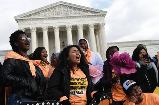 People protest outside the Supreme Court in Washington on Friday. The U.S. Supreme Court on Tuesday will take up the Trump administration's plan to end legal protections that shield nearly 700,000 immigrants from deportation, in a case with strong political overtones amid the 2020 presidential election campaign.