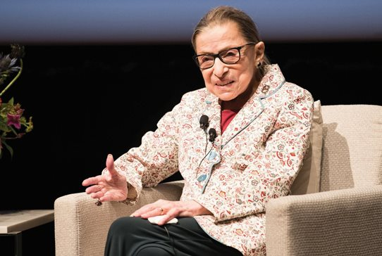 Supreme Court Justice Ruth Bader Ginsburg speaks with the audience at Reva and David Logan Center for the Arts at the University of Chicago on Monday. Ginsburg expressed the hope that partisanship could be removed from the Supreme Court affirmation process.