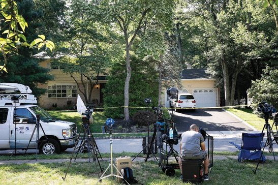News media is set up in front of the home of U.S. District Judge Esther Salas in North Brunswick, N.J. in July. Last Friday, New Jersey Gov. Phil Murphy signed a bill into law that protects the personal information of judges and other law enforcement personnel from being publicly available. The law is named after Daniel Anderl, Salas' son who was slain at the family home by a disgruntled attorney who had targeted Salas and other judges.