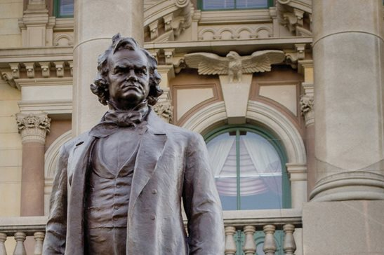 A statue of Stephen Douglas on the Illinois statehouse grounds. House Speaker Michael Madigan on Thursday called for a removal of Douglas' image from the Capitol. Capitol News Illinois photo/Jerry Nowicki