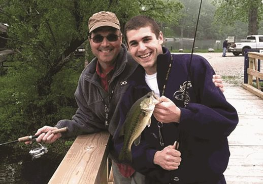 Former Salvi, Schostok & Pritchard partner Michael P. Schostok fishes with his son, Michael J. Schostok, in a family photo. The elder Schostok died in 2012 after a battle with brain cancer. On Thursday, the son was admitted as an Illinois attorney and joined Salvi Law as its newest associate.
