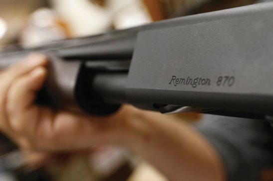 The Remington brand name is etched on a model 870 shotgun displayed at a Pennsylvania sport shop. For years, the gun industry has been immune from most lawsuits, but a recent ruling allowing families of victims in the Newton school shooting to challenge the way an AR-15 used by the shooter was marketed is upending that longstanding roadblock. The U.S. Supreme Court recently rejected efforts by Remington to quash the lawsuit, allowing it to continue in Connecticut courts.