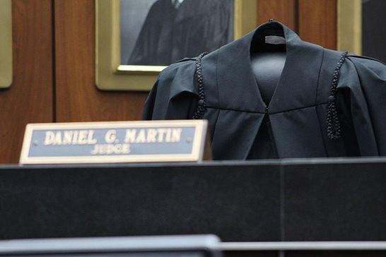 On Tuesday afternoon, the U.S. District Court for the Northern District of Illinois celebrated the late U.S. District Judge Daniel G. Martin, who passed away Oct. 11, at a memorial in the Ceremonial Courtroom where his colleagues on the federal magistrate bench left an empty seat with Martin's robe and his name plate.